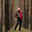 Stock Photo: Young alone women in forest