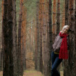 Photo: Young alone women in forest