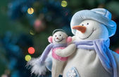 Snowman with his little baby — Stock fotografie