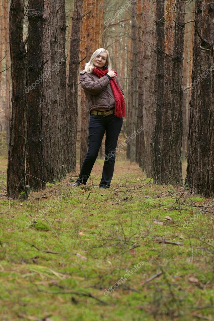 Young alone women in pine forest — Stock Photo #12714364