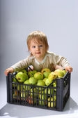 Baby boy with apples — Stock Photo