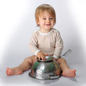 Baby boy with the kitchen tools — Stock Photo