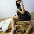 Young girl with several natural fur coats — Stockfoto