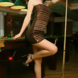 Young girl in snooker bar — Stock Photo #17518999