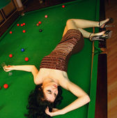 Young girl in snooker bar — Stock Photo