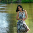 Nice woman near river — Stockfoto