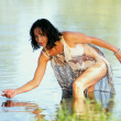 Nice woman near river — Foto Stock