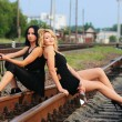 Girl drink wine on the railroad track — Stock Photo