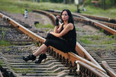 Young girl relaxed on the railroad track — Stock Photo