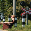 Girl on the railroad track — Stock Photo