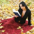 Nice girl outdoor with book — 图库照片