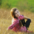 Teen girl sitting on the ground — Stock Photo