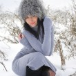 Nice girl in the winter landscape outdoor — Stock Photo #39556439