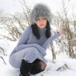 Nice girl in the winter landscape outdoor — Stock Photo #39556441