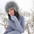 Nice girl in the winter landscape outdoor — Stock Photo #39556445