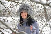Nice girl in the winter landscape outdoor — Stockfoto