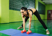 Young girl doing fitness exercise — Stock Photo