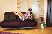 Girl in the hose after housework — Foto de Stock
