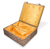 Open fabric covered oriental box — Stock Photo