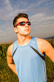 Jogging through the fields — Stock Photo