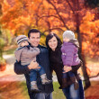 Family in the autumn park — Stock Photo