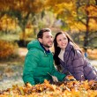 Couple in the autumn park — Stock Photo