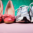 High Heels and runners - Stock Photo