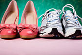 High Heels and runners — Stock Photo