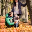 Family in the autumn park — Stock Photo #15648835