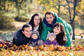 Family in the autumn park — Стоковое фото