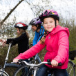 Cycling family — Stock Photo #25573043
