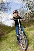 Cycling girl — Stock Photo