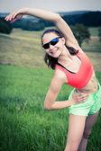 Stretching woman — Stock Photo