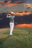 Playing golf — Stockfoto