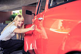 Woman with a classic car — Stock Photo
