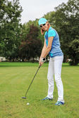 Playing golf — Stock Photo
