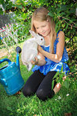 Girl with rabbit — Stockfoto