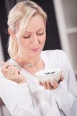 Woman with yogurt bowl — Stock Photo