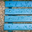 Stock Photo: Bench after rain