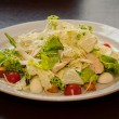Salad from the Beijing cabbage with chicken tomatoes onions and crackers — Stock Photo