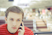 Young casual man talking on the phone — Stock Photo