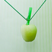 Green apple hanging on the rope — Stock Photo