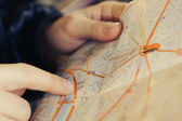 Hand pointing on map of Paris — Stock Photo