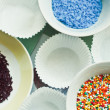 Sugar sprinkles on the plates — Stock Photo