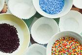 Sugar sprinkles on the plates — Stock Photo