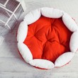 Red pet mattress in the room with cage — Stock Photo