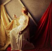 Femida styled photo as a painting on canvas — Stock Photo
