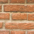 Background of red stone bricks wall texture — Stock Photo