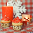Christmas cupcakes on the coloured background — Stock Photo