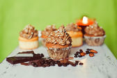 Group of cupcakes on the green background — Stock Photo